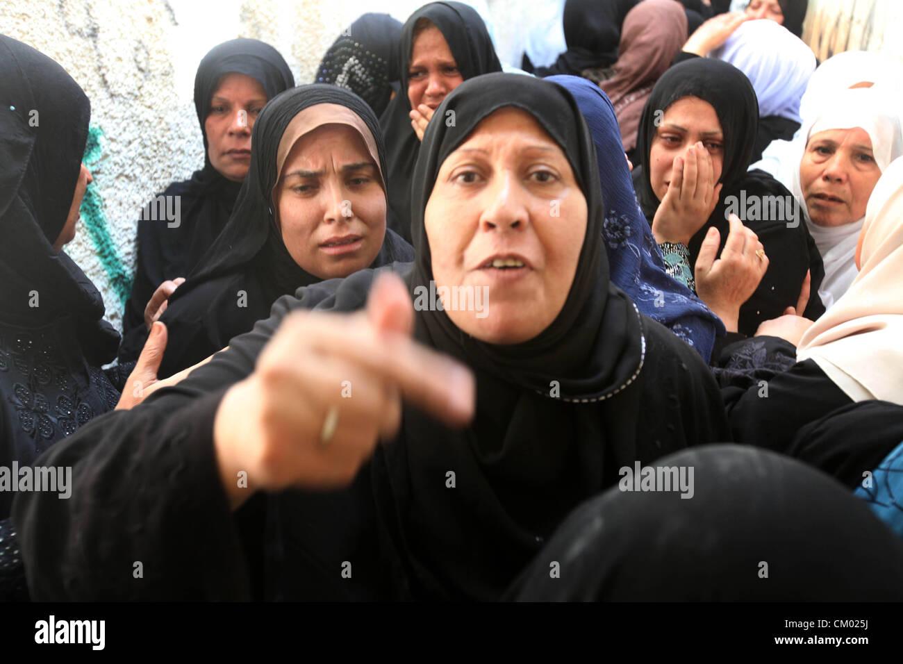 Sept. 6, 2012 - Gaza City, Gaza Strip, Palestinian Territory - Palestinian relatives of Zakaria Al Gammal during - Stock Image