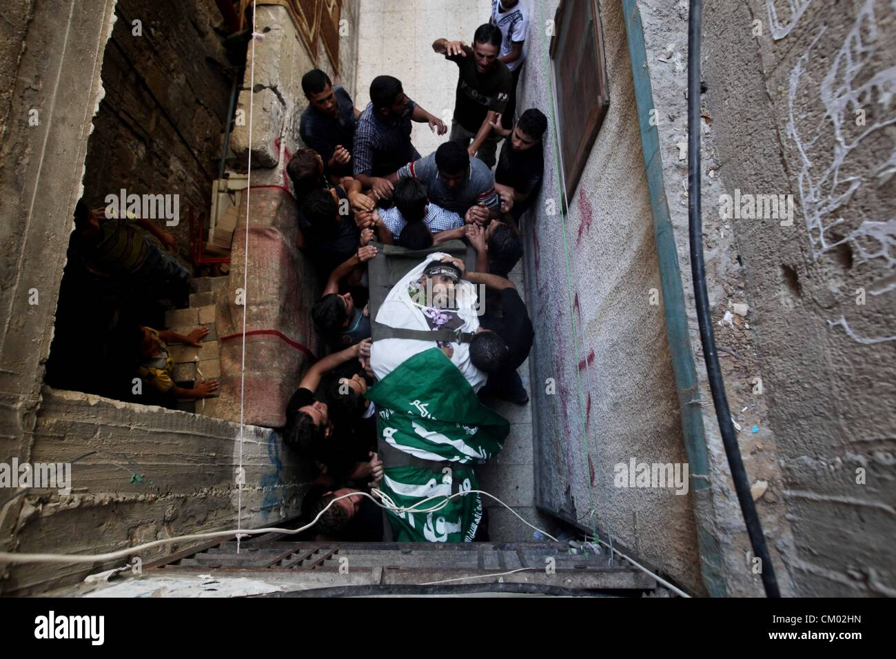 Sept. 6, 2012 - Gaza City, Gaza Strip - Mourners carry the body of ZAKARIA AL GAMMAL during his funeral, after an - Stock Image