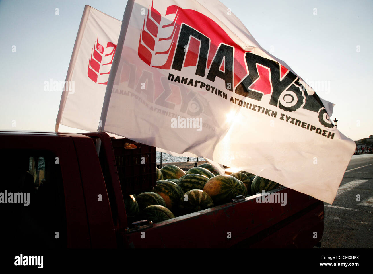 Thessaloniki, Greece. 8th September, 2012. Agricultural truck full of watermelons and flags from labor union during - Stock Image