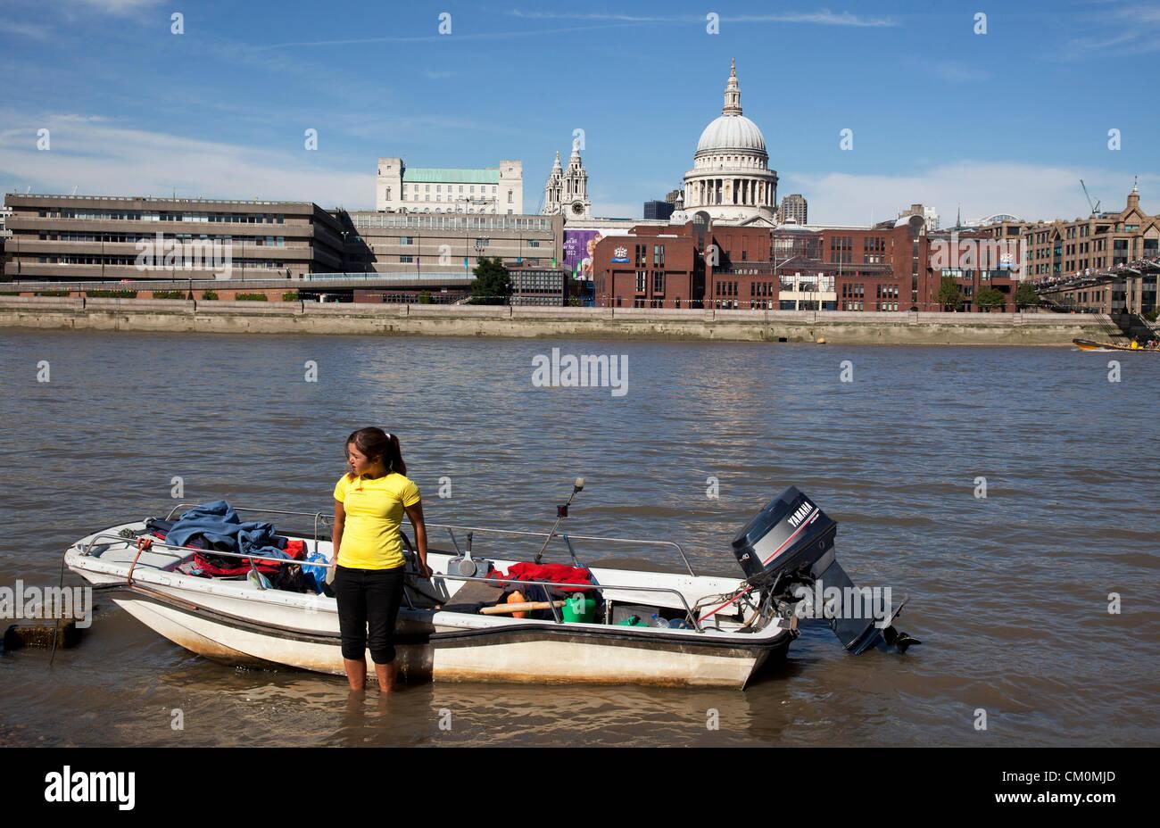 London, UK. 8th September, 2012. Girl holds on to her motor boat on the river Thames. The Mayor's Thames Festival - Stock Image