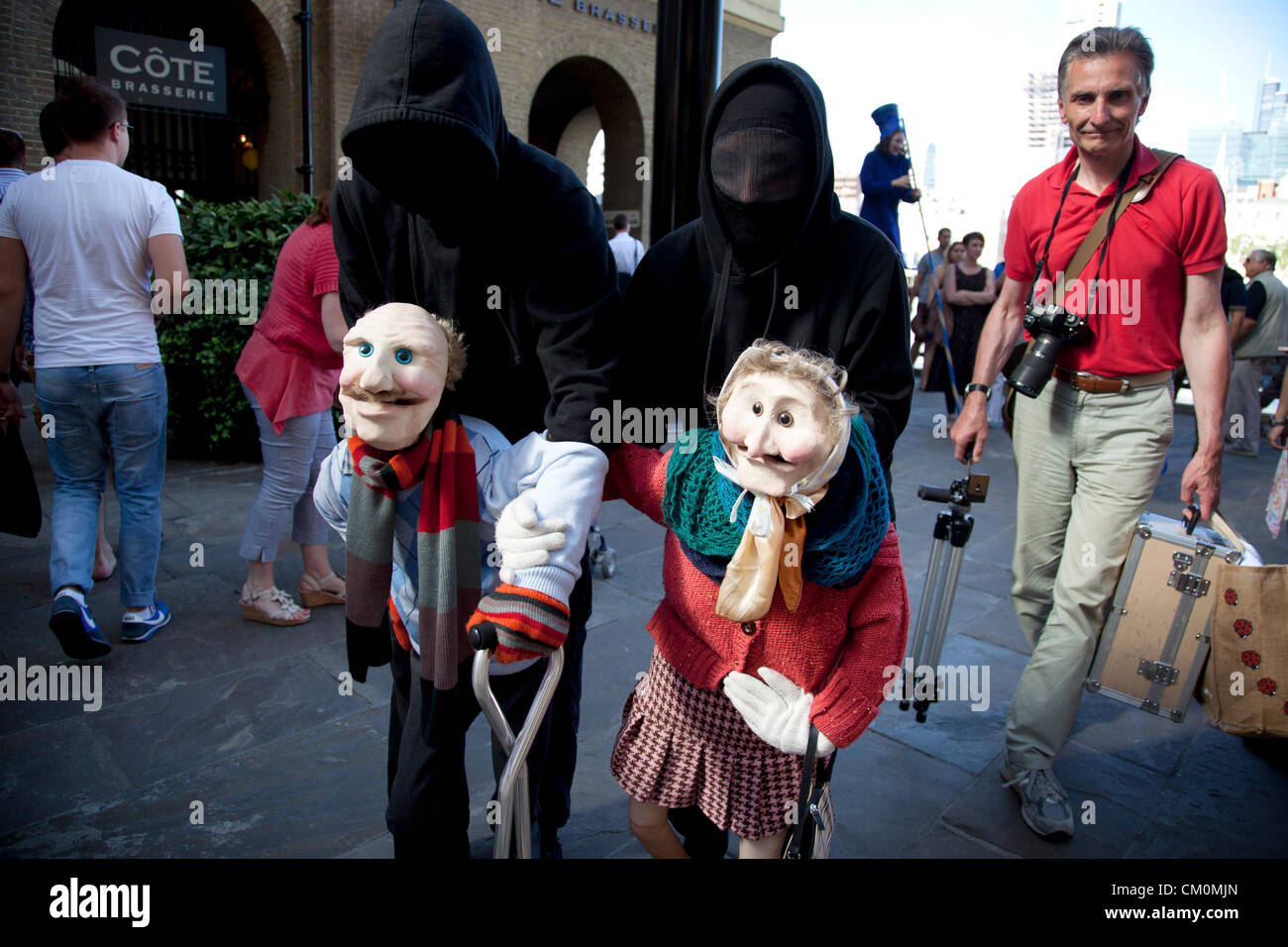 London, UK. 8th September, 2012. Never Too Old... a puppet show where an elderly couple walk around interracting - Stock Image