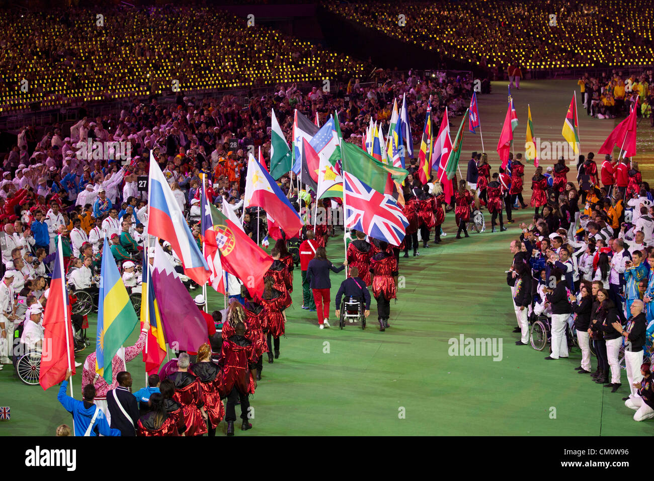 Athletes carry their countries' flags into Olympic Stadium at the closing ceremony of the 2012 Paralympic Games Stock Photo