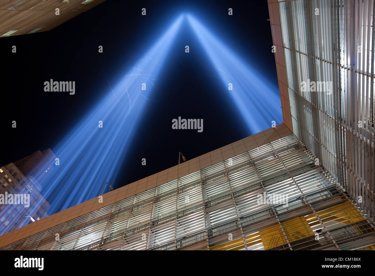 The twin beams of light of the Tribute in Light, an annual remembrance of the events of September 11, 2001, shine - Stock Image