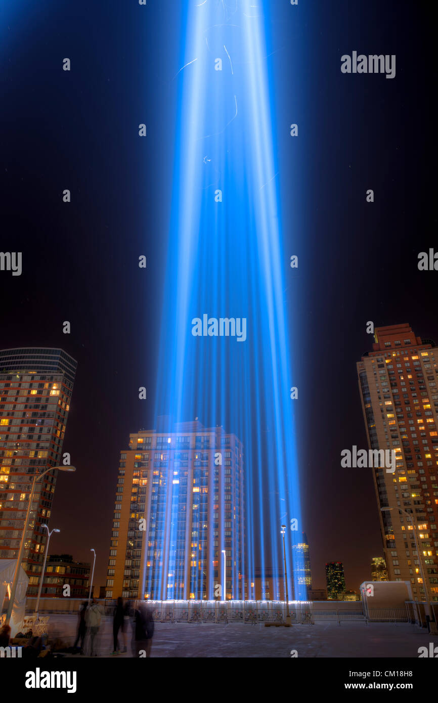One of the beams of light of the Tribute in Light, an annual remembrance of the events of September 11, 2001, shines - Stock Image