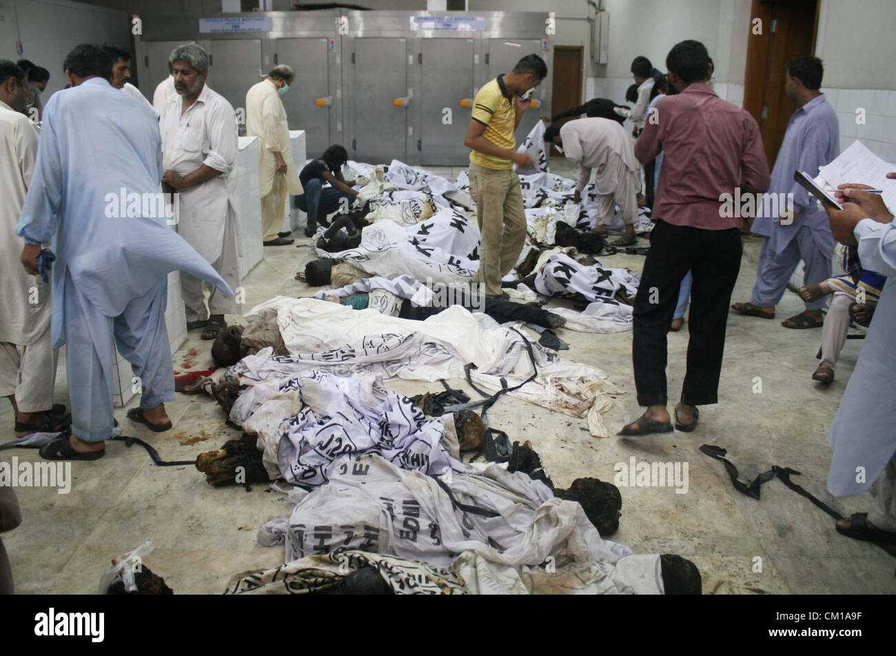 Karachi, Pakistan  SEP 12, 2012  Relatives searching dead bodies of