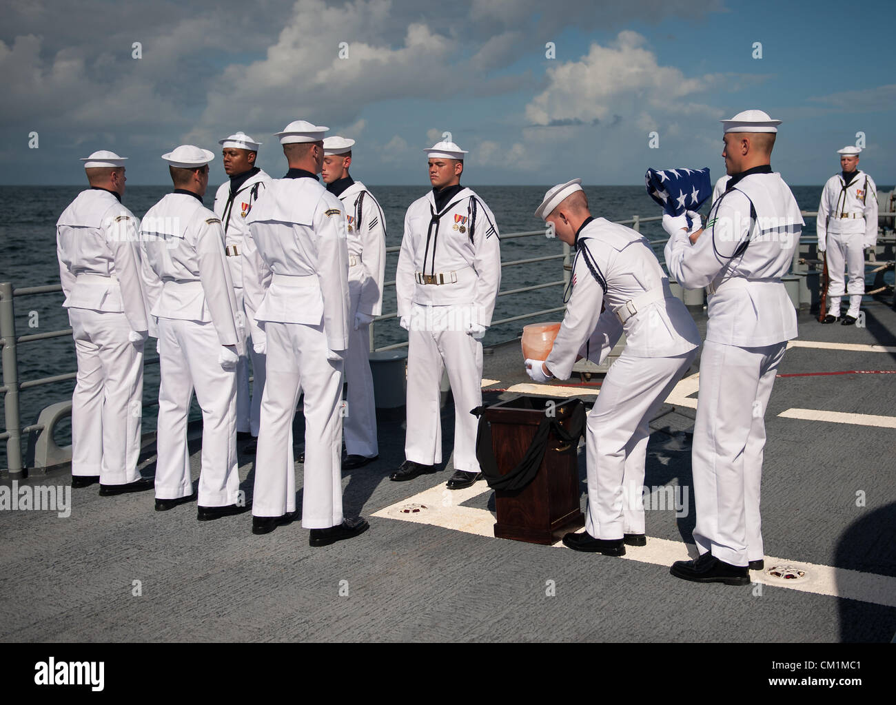 US Navy personnel carry the remains of Apollo 11 astronaut Neil Armstrong during the burial at sea service for her Stock Photo