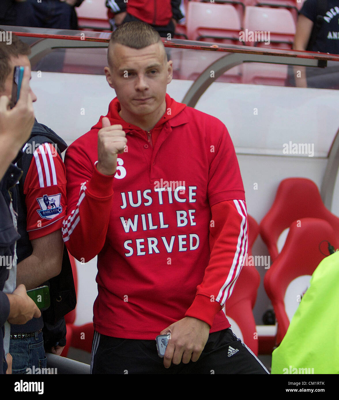 Barclays English Premier League Football - Sunderland AFC v Liverpool FC.Sunderland fan shows his support for Liverpool - Stock Image