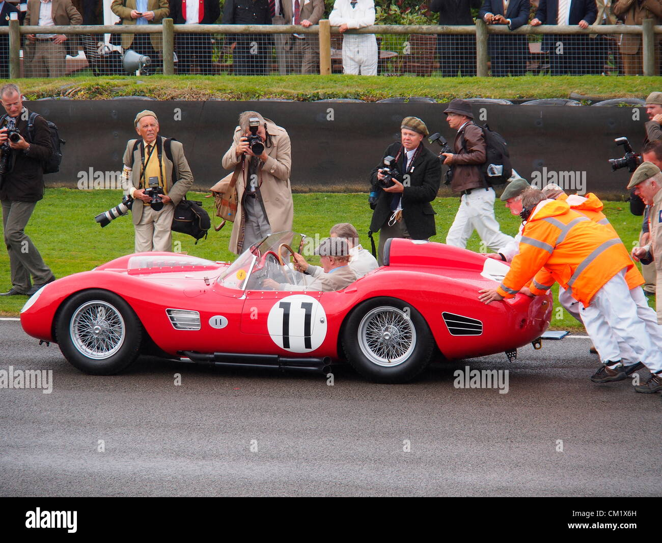 Goodwood Revival Practice Day Friday September 14th.2012. Historic racing car number 11 with driver and passenger - Stock Image