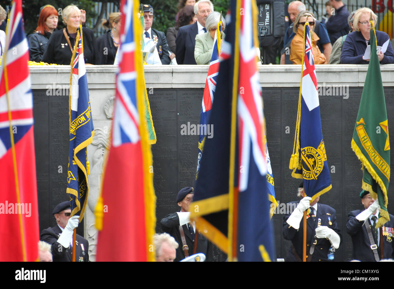 Trinity Square Gardens, London, UK. 16th September 2012. Standard Bearers and the crowd look on. The Merchant Navy - Stock Image