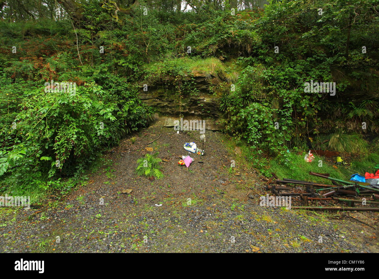 Cilybebyll, South Wales, UK. Sunday 16 September 2012  Pictured: Floral tributes, a miner's spade and helmet - Stock Image