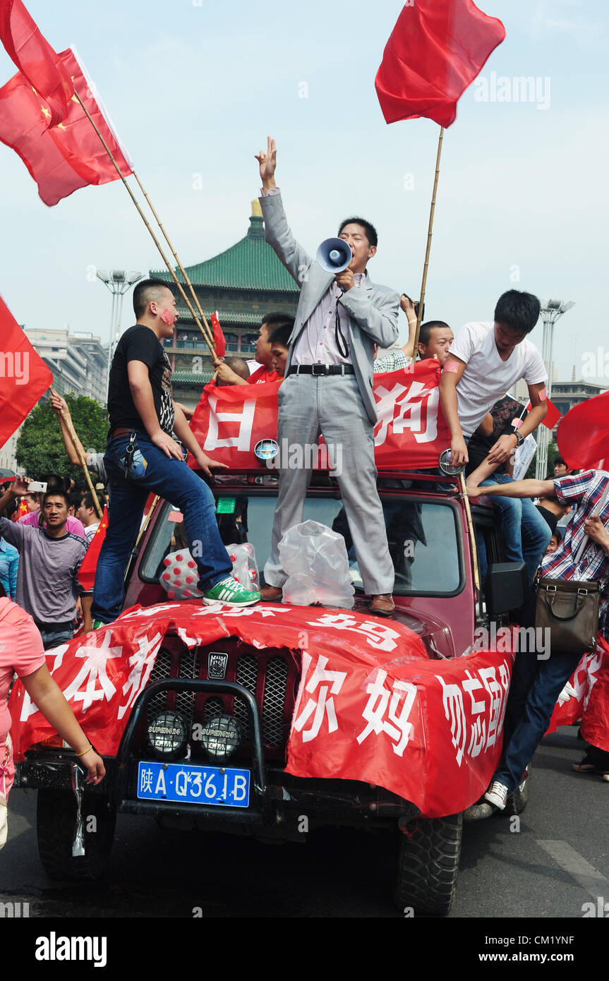 Xian,China. Saturday 15th September, 2012. Anti-Japanese protesters have a demonstration at the gate of Bell Tower Stock Photo