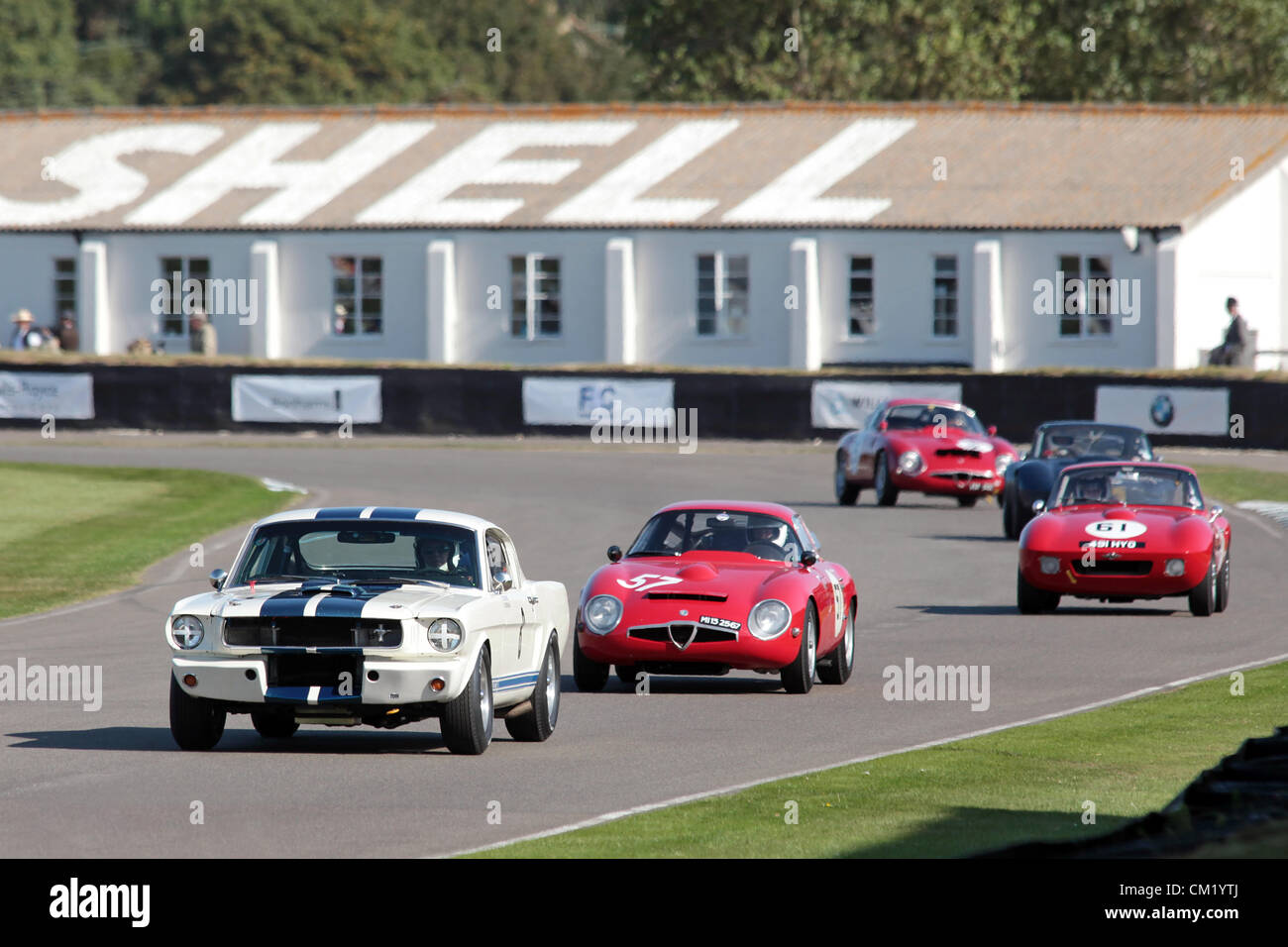 Goodwood Estate, Chichester, UK. 15th September 2012. Jeremy Cooke pictured driving a white 1966 Ford Shelby Mustang - Stock Image