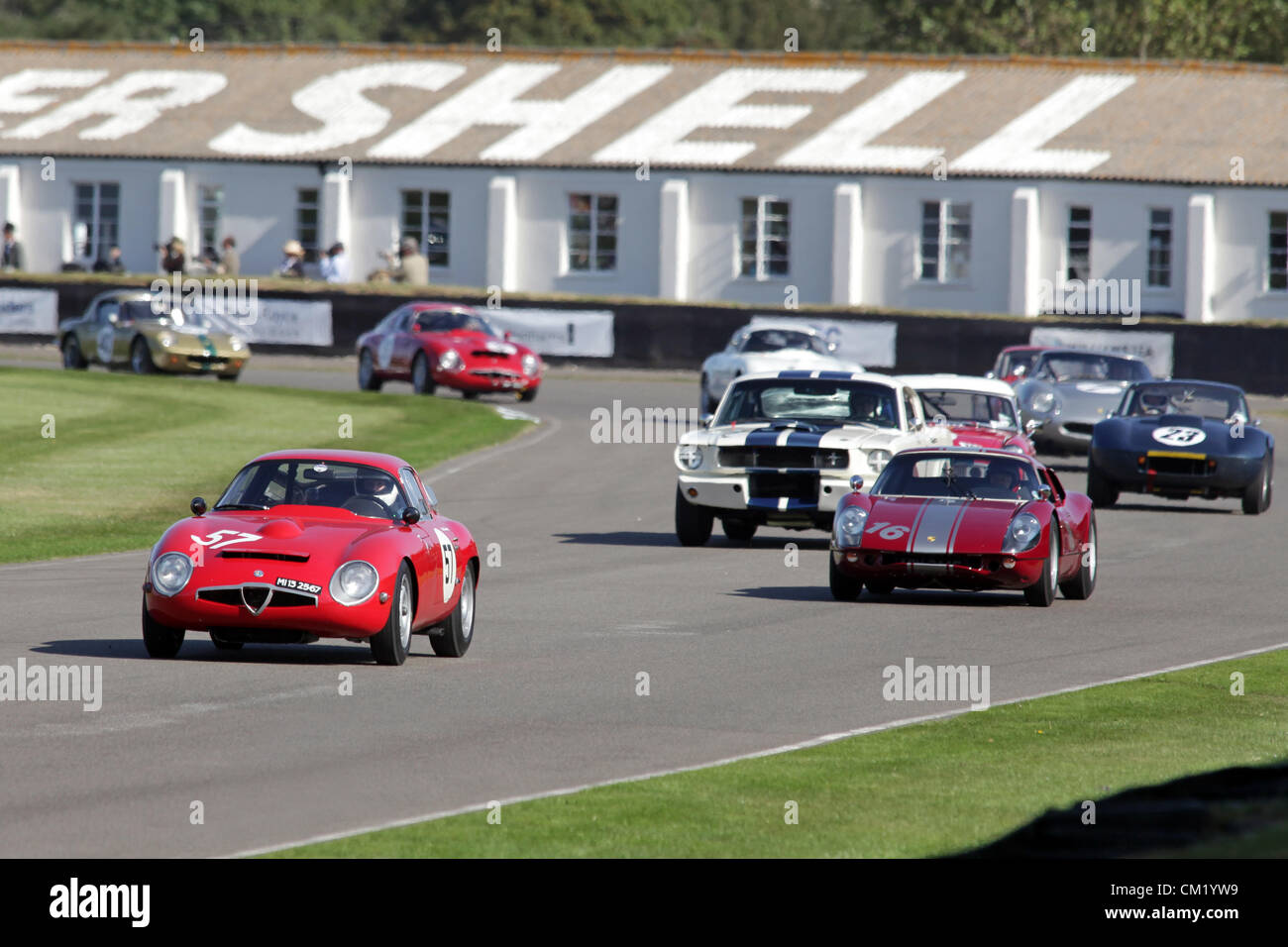 Goodwood Estate, Chichester, UK. 15th September 2012. Charles Knill-Jones driving a red 1963 Alfa Romeo Giulia TZ1 - Stock Image