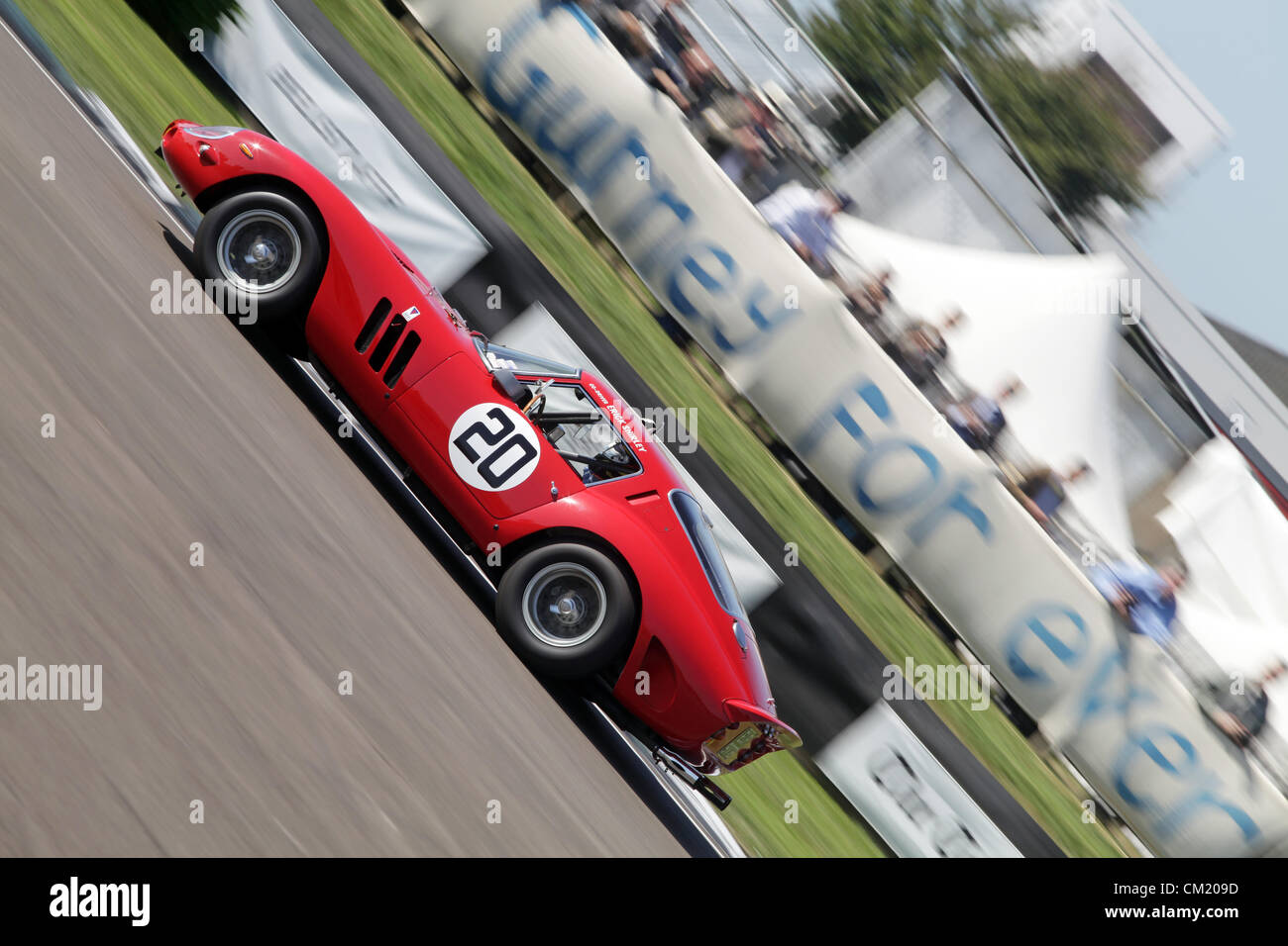Goodwood Estate, Chichester, UK. 15th September 2012. Derek Bell driving a 1962 Ferrari GTO during the RAC TT Celebration. - Stock Image