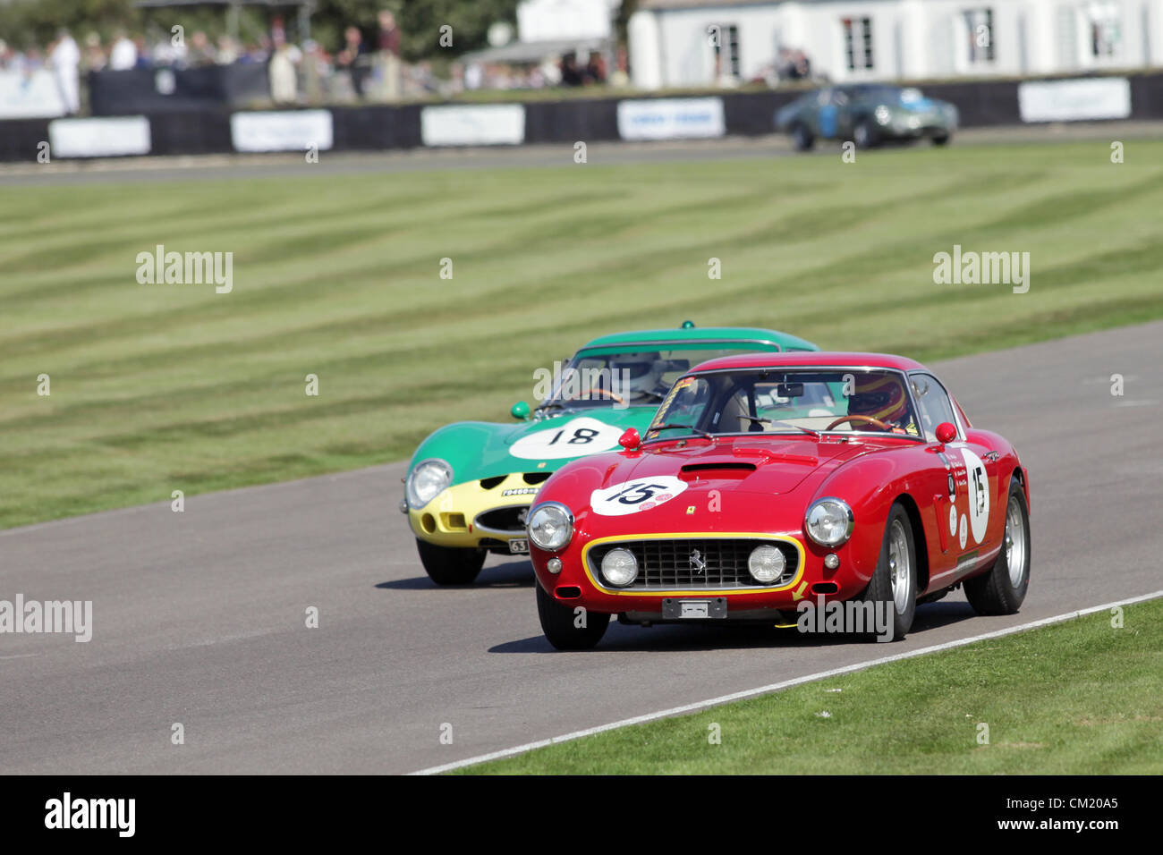 Goodwood Estate, Chichester, UK. 15th September 2012. Arturo Merzario pictured driving a red 1960 Ferrari 250 GT - Stock Image
