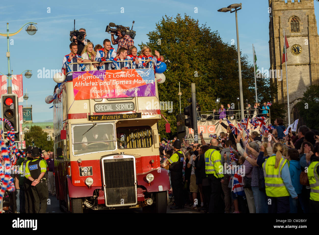 Plymouth, UK. 19/09/2012. An open top bus for Plymouth Olympians and Paralympians passes thousands of Plymouth people Stock Photo