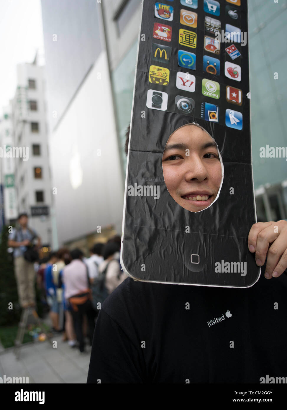 Japan, Tokyo. 21st September 2012. Japanese Apple fan waits in line for his new iphone 5 on the day of the release. Stock Photo