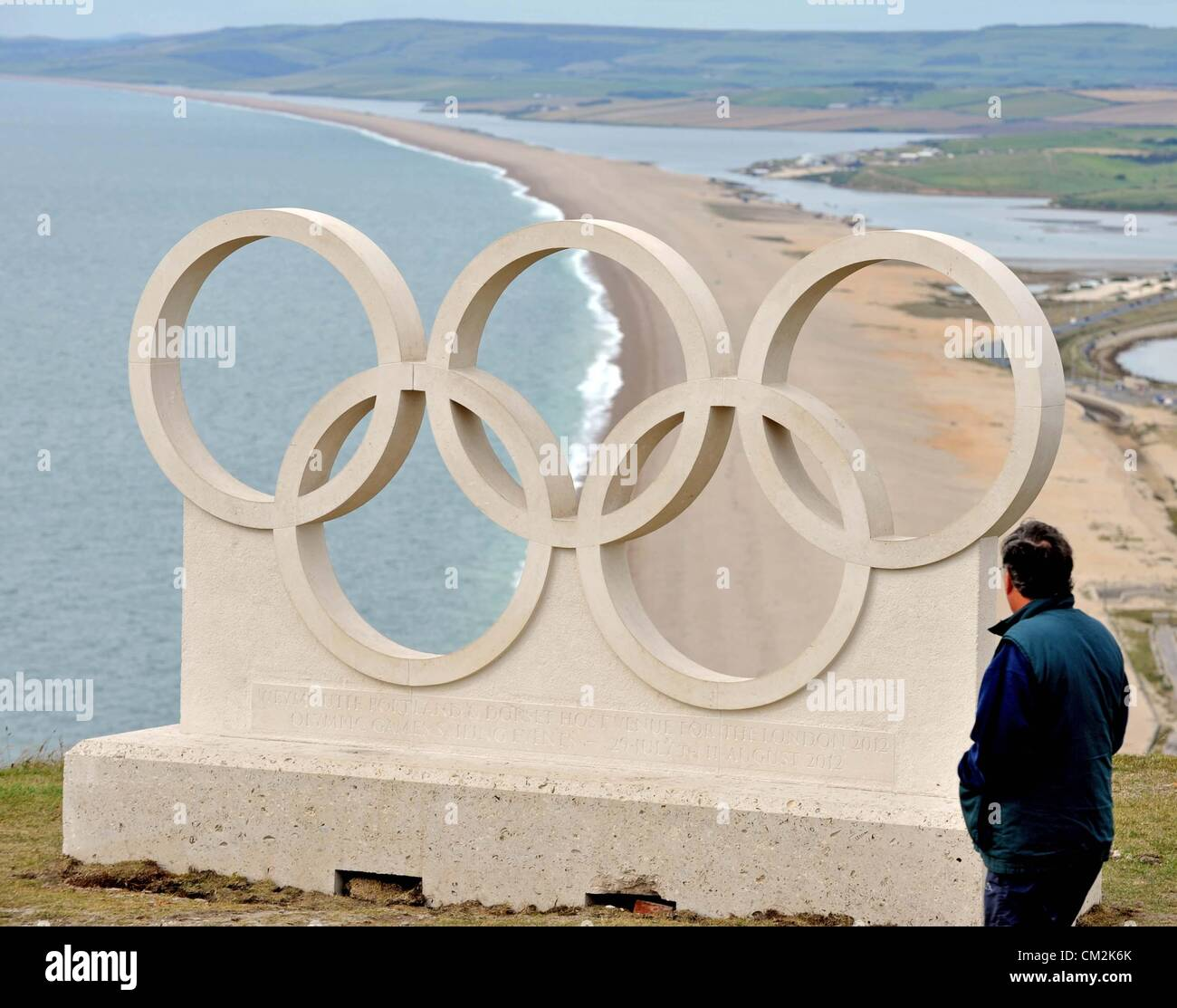 Dorset's Olympic rings given pride of place at the popular viewpoint above Chesil Beach on Portland. One of the Stock Photo