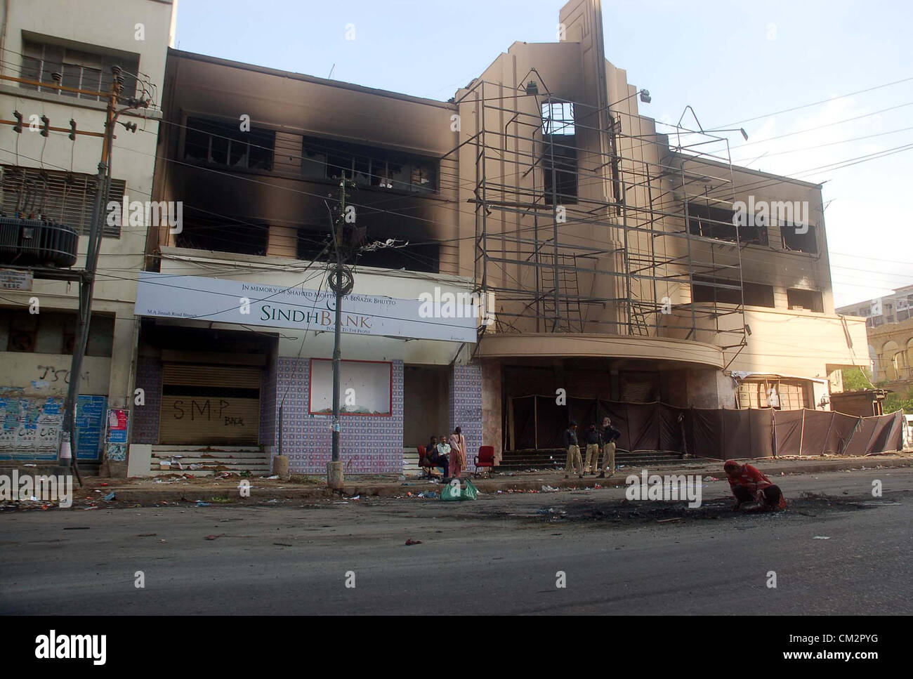 View of burnt and destroyed cinema at M A Jinnah road in