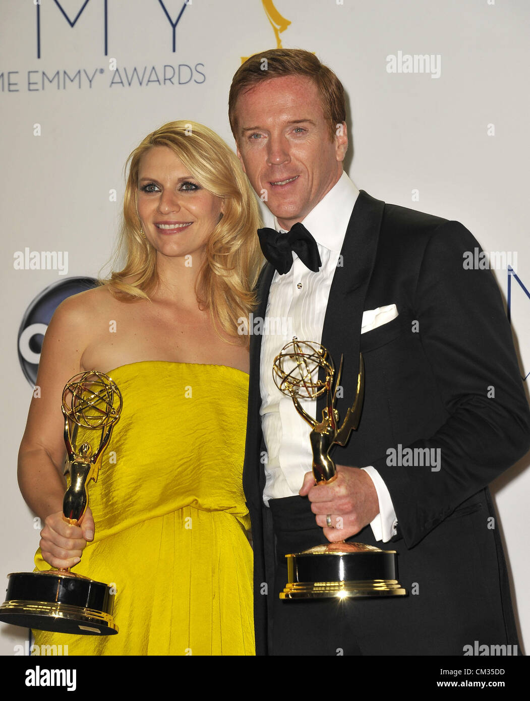 Sept. 23, 2012 - Los Angeles, California, U.S. - Actors CLAIRE DANES and DAMIAN LEWIS with their Emmys for 'Homeland' - Stock Image