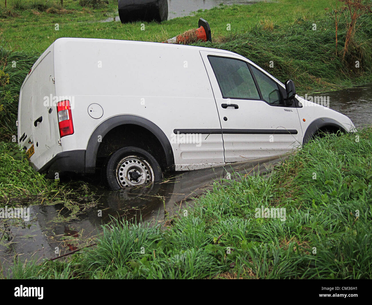 Badgworth, Somerset, UK. 24th September, 2012. A small van in a ditch on the A38 in Somerset, near Badgworth (junction - Stock Image