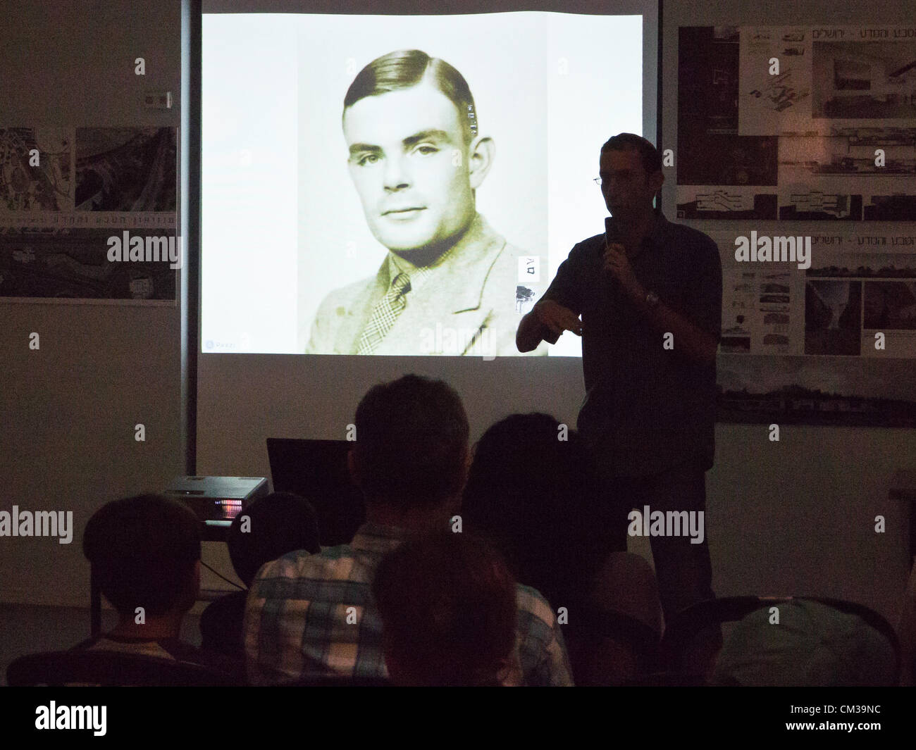 Museum visitors take part in a lecture on this year's Researchers Night theme, Alan Mathison Turing, considered - Stock Image