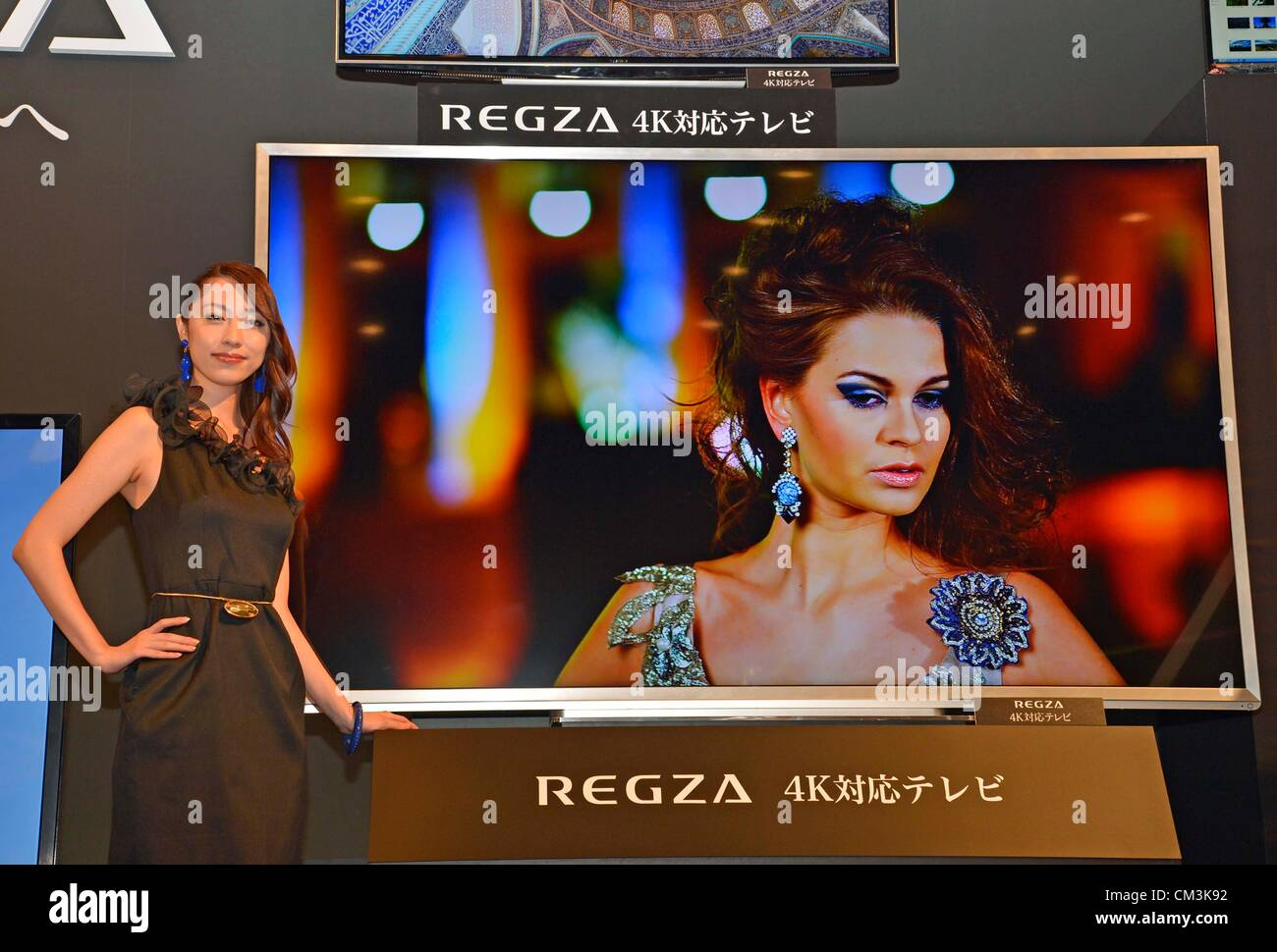 Model presents 84-inch Quad Full HD resolution TV at the