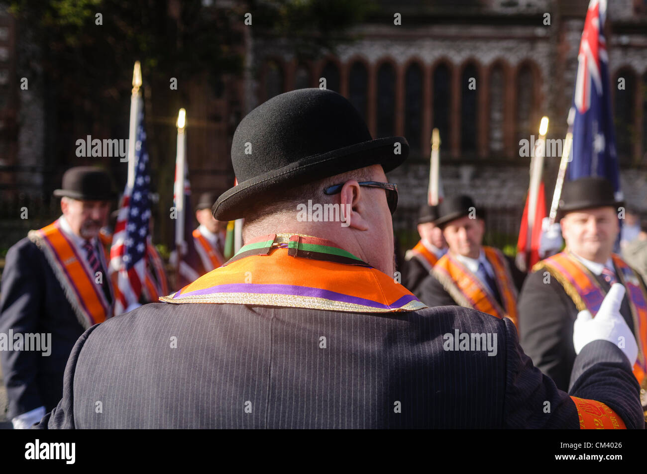 Orange Order official gives directions to fellow Orangemen during a briefing at the start of a parade - Stock Image