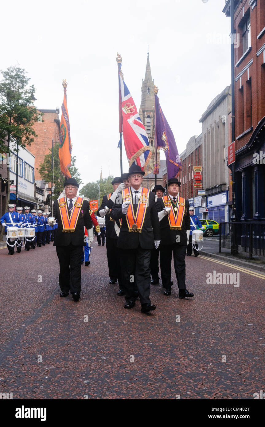 Orangemen parade past St Patricks Roman Catholic Church in Belfast.  This is a contentious flashpoint between the Stock Photo