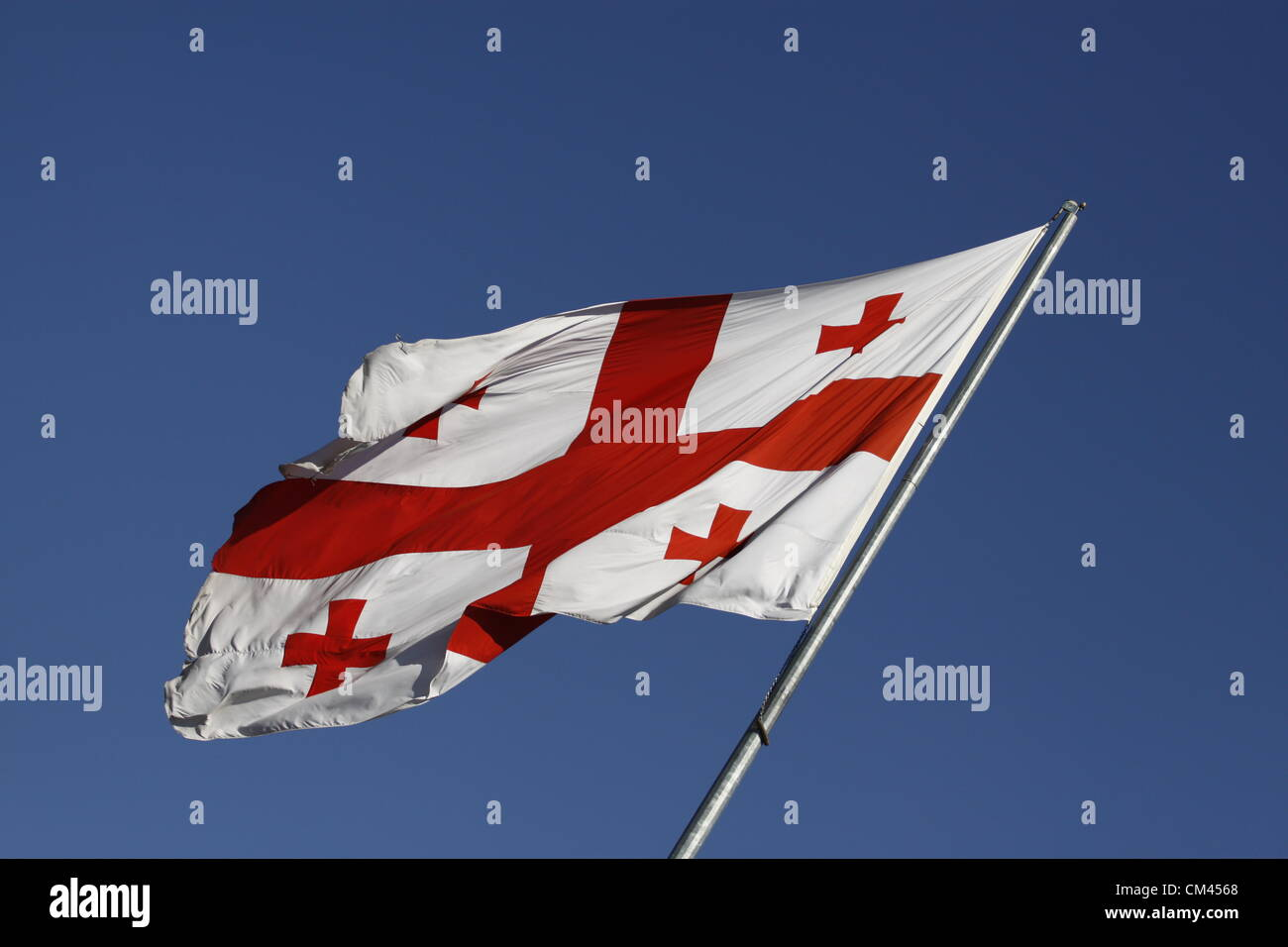 30 September 2012 - Tbilisi, Georgia - Giant Georgian flag fluttering in the wind over Aghmashenebeli Avenue, near - Stock Image