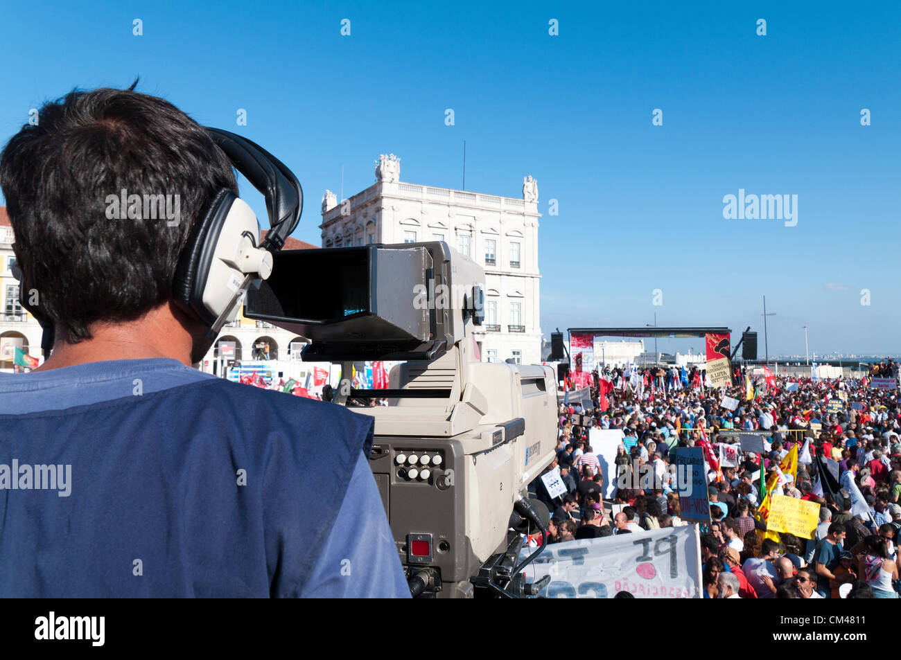 Cameraman / reporter / photographer covering the peaceful protest organised by the CGTP union gathers activists - Stock Image