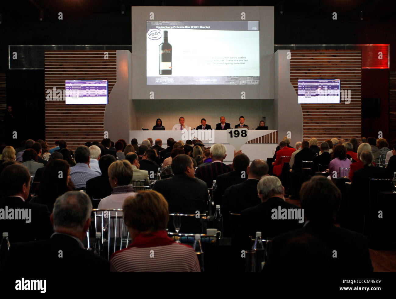 Bidders at the annual Nederburg Wine Auction, Paarl, South Africa, 29 September 2012. Foreign buyers bought 40% - Stock Image