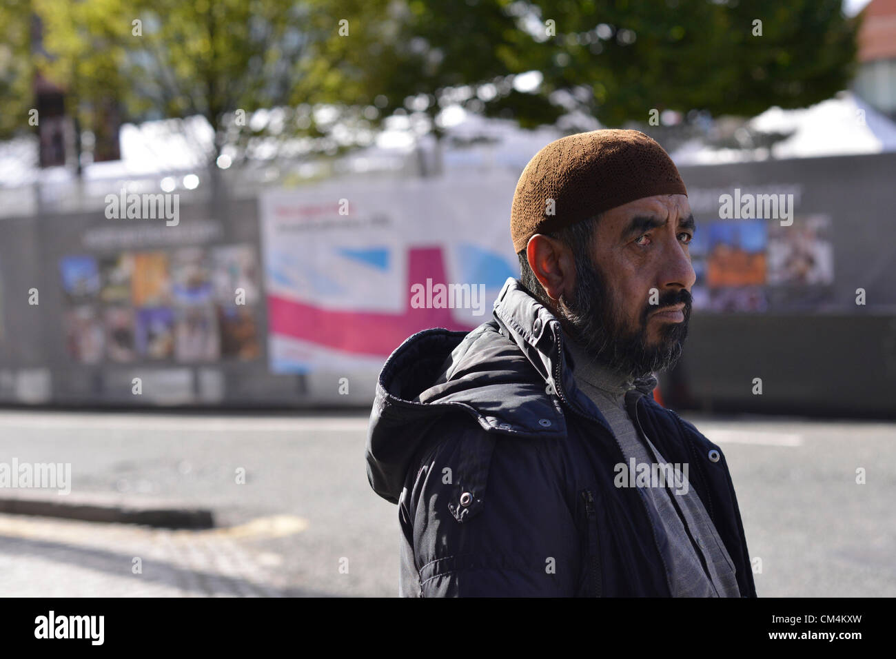 Manchester, UK. 3rd October 2012. A man walks past  Manchester Central, the venue for The Labour Party Annual Conference, - Stock Image