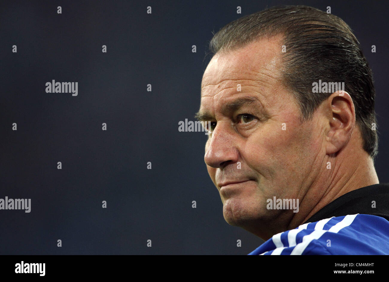Gelsenkirchen, Germany. 3rd October 2012.  Schalke's coach Huub Stevens reacts during the UEFA Champions League - Stock Image