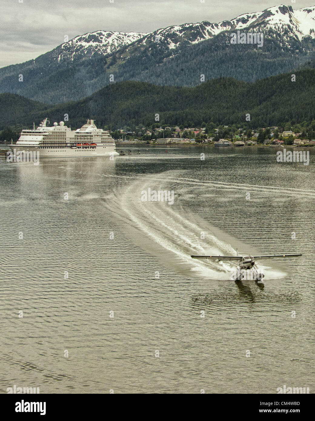 July 5, 2012 - Borough Of Juneau, Alaska, US - In the Gastineau Channel, returning to Juneau, a Wings Airways DeHavilland - Stock Image