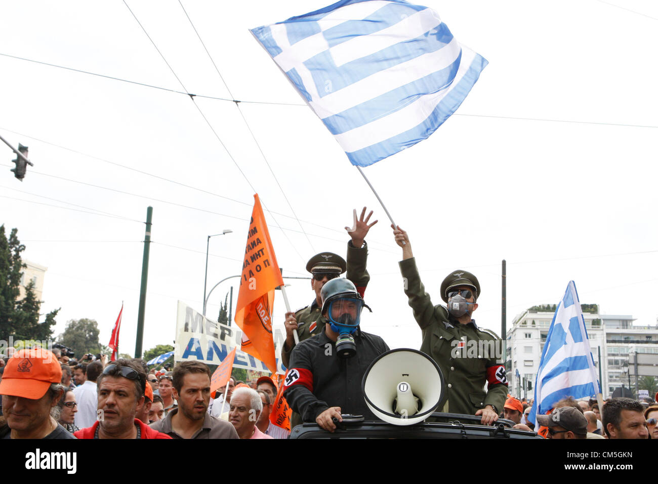Oct. 9, 2012 - Athens, Greece - Two men dressed as German World War II soldiers with Nazi swastika armbands sit - Stock Image