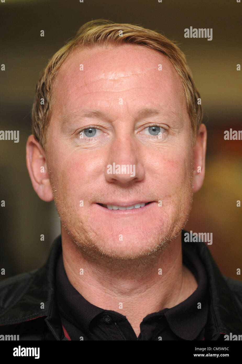 Arsenal football legend Ray Parlour opens a builder's merchants in Dorchester, Dorset, Britain, UK  11th October - Stock Image