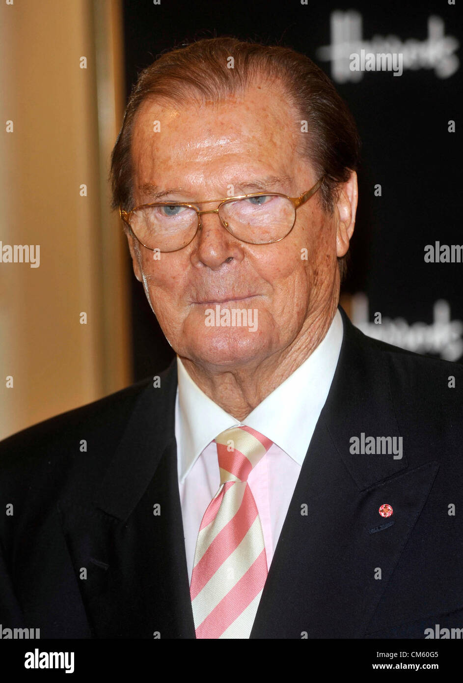 Sir Roger Moore signing copies of his book 'Bond on Bond' at Harrods, Knightsbridge London - October 11th - Stock Image