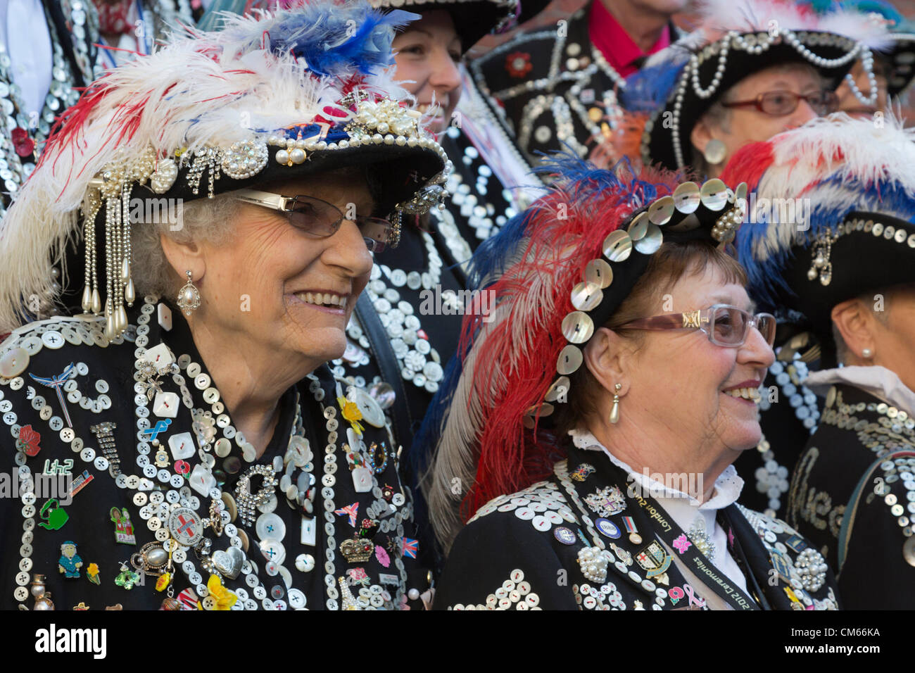 Pearly Kings & Queens from the Pearly Kings & Queens Society gather at St. Paul's Church in Covent Garden - Stock Image