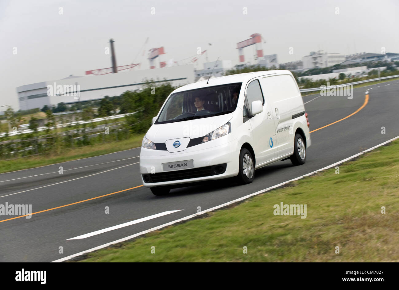 Photo shows a prototype of Nissan's e-NV200 electric vehicle during a test run at the automaker's Oppama - Stock Image