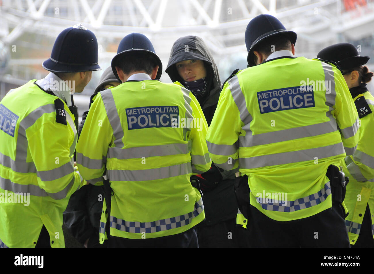 Embankment, London, UK. 20th October 2012. Two young men being spoken to by police officers on the Embankment. TUC - Stock Image