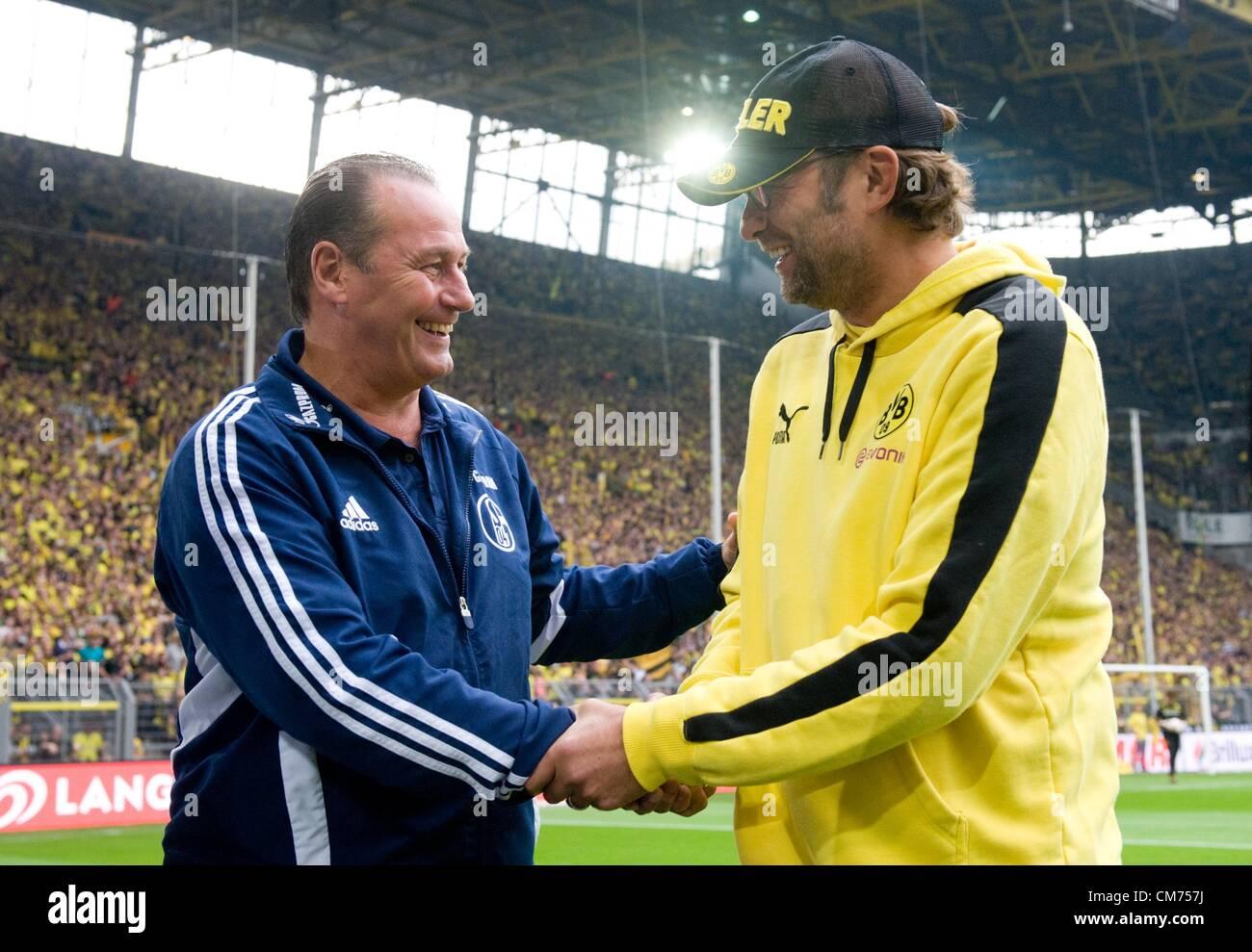 Dortmund, Germany. 20th October 2012.  Dortmund's head coach Juergen Klopp (R) shakes hands with Schalke head - Stock Image