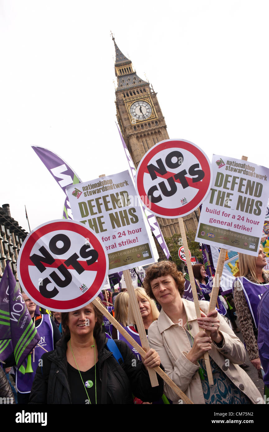 London, UK - 20 October 2012: two women hold signs reading 'No Cuts' and 'Defend the NHS' during - Stock Image