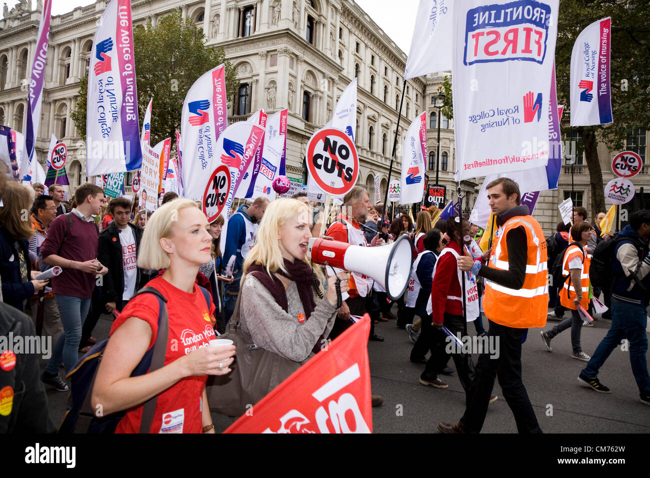 London, UK. 20th October 2012. Marchers and protestors in Whitehall pass the end of Downing Street on the TUC 'A - Stock Image