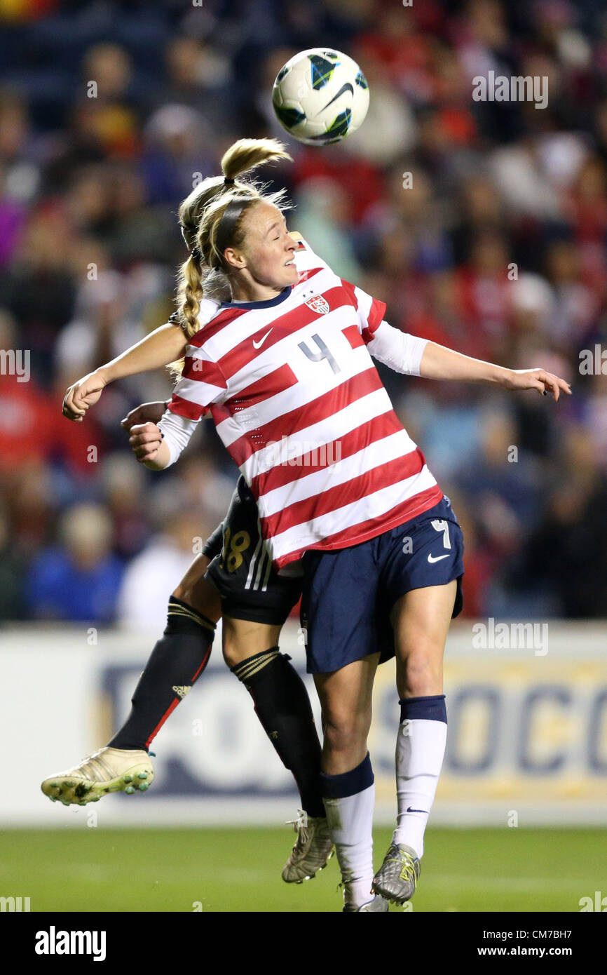 20.10.2012. Chicago, USA.  Becky Sauerbrunn (USA) (4) heads the ball away from Svenja Huth (GER) (18). The United - Stock Image