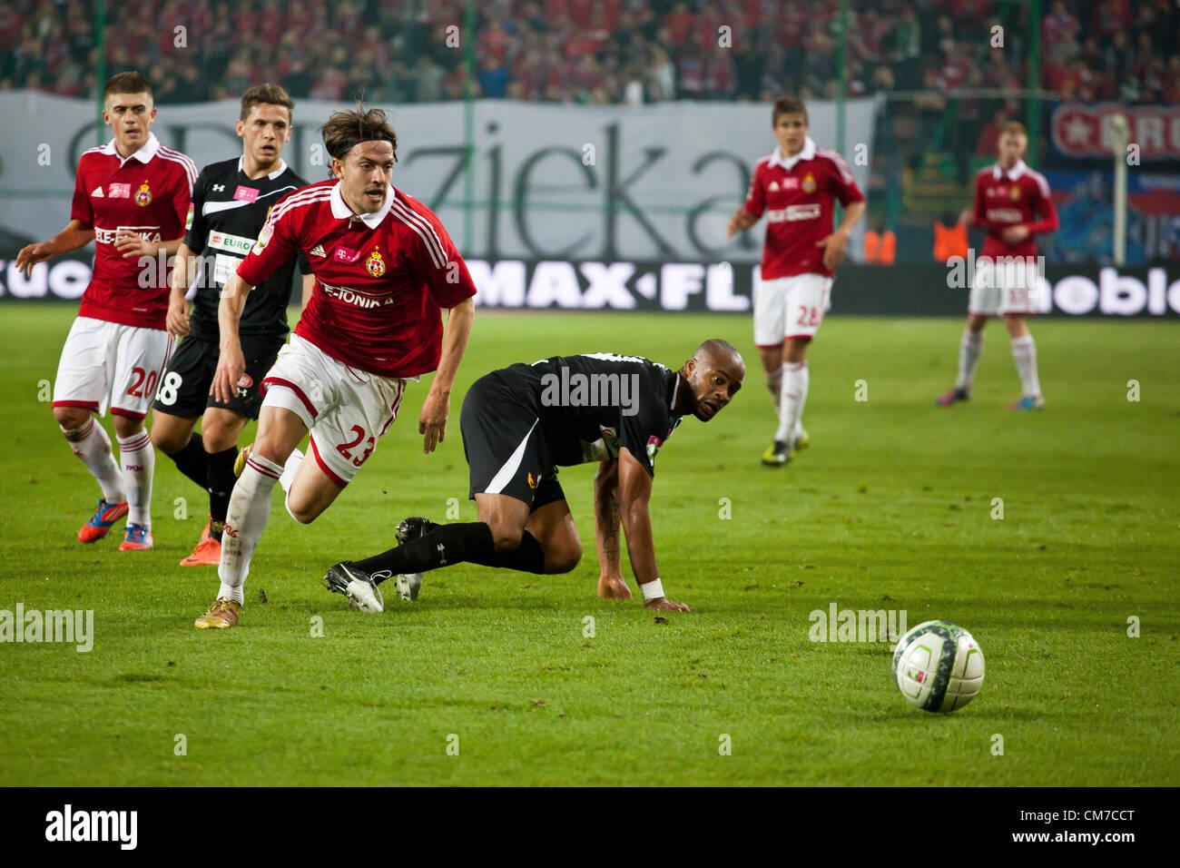 October 20, 2012 Cracow, Poland - Eighth round of Polish Football Extraleague. (L) Daniel Sikorski and (C) Ugochukwu - Stock Image