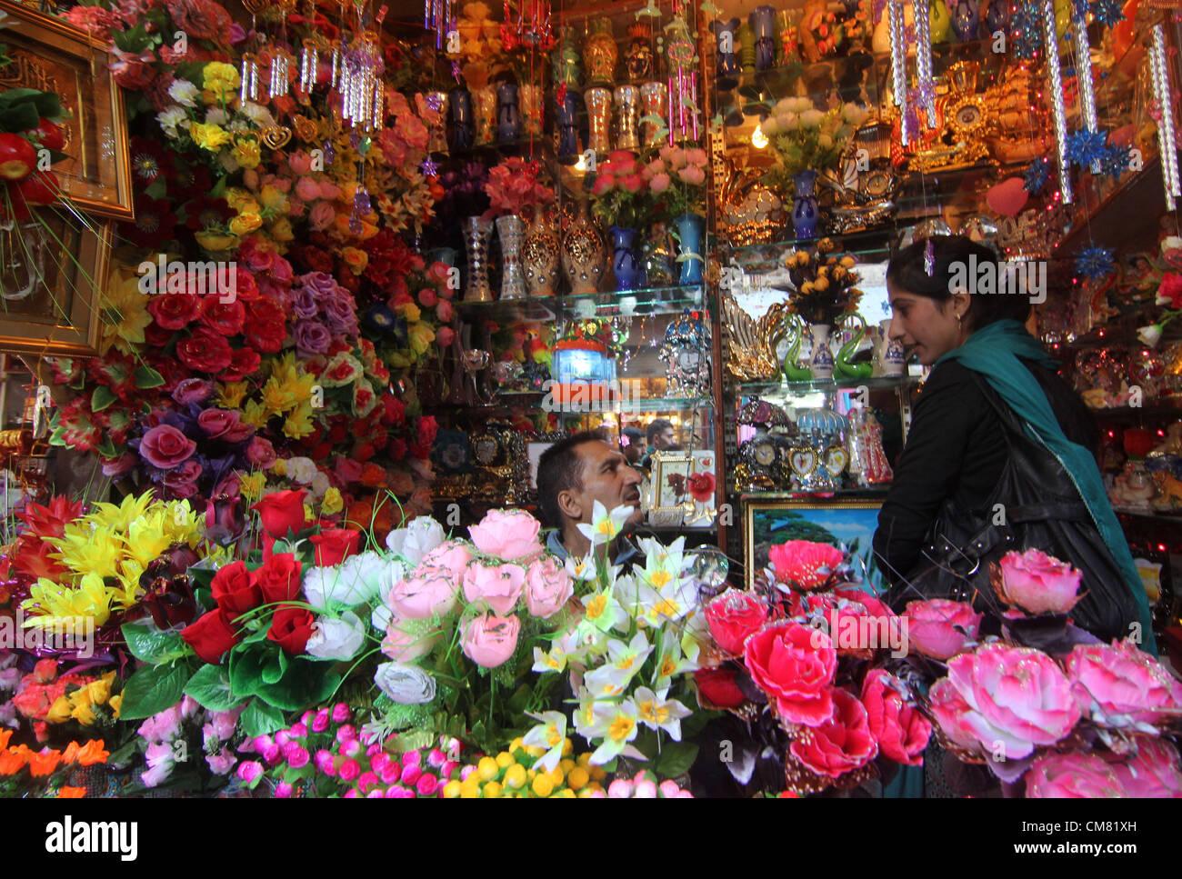 A kashmiri muslim girl stock photos a kashmiri muslim girl stock oct 25 2012 a kashmiri muslim girl purchases flowers from a flower shop izmirmasajfo