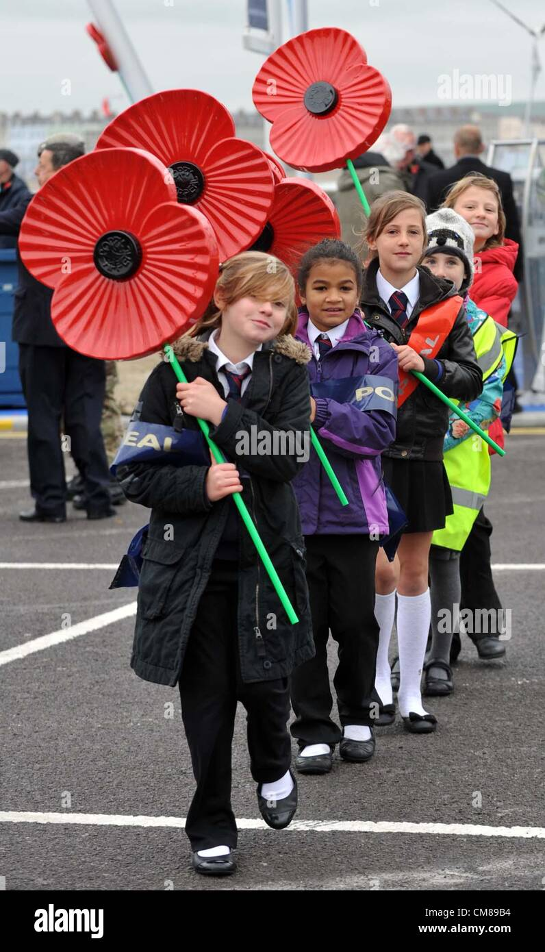 School children hold giant poppies as part of the Royal British Legion appeal - Stock Image