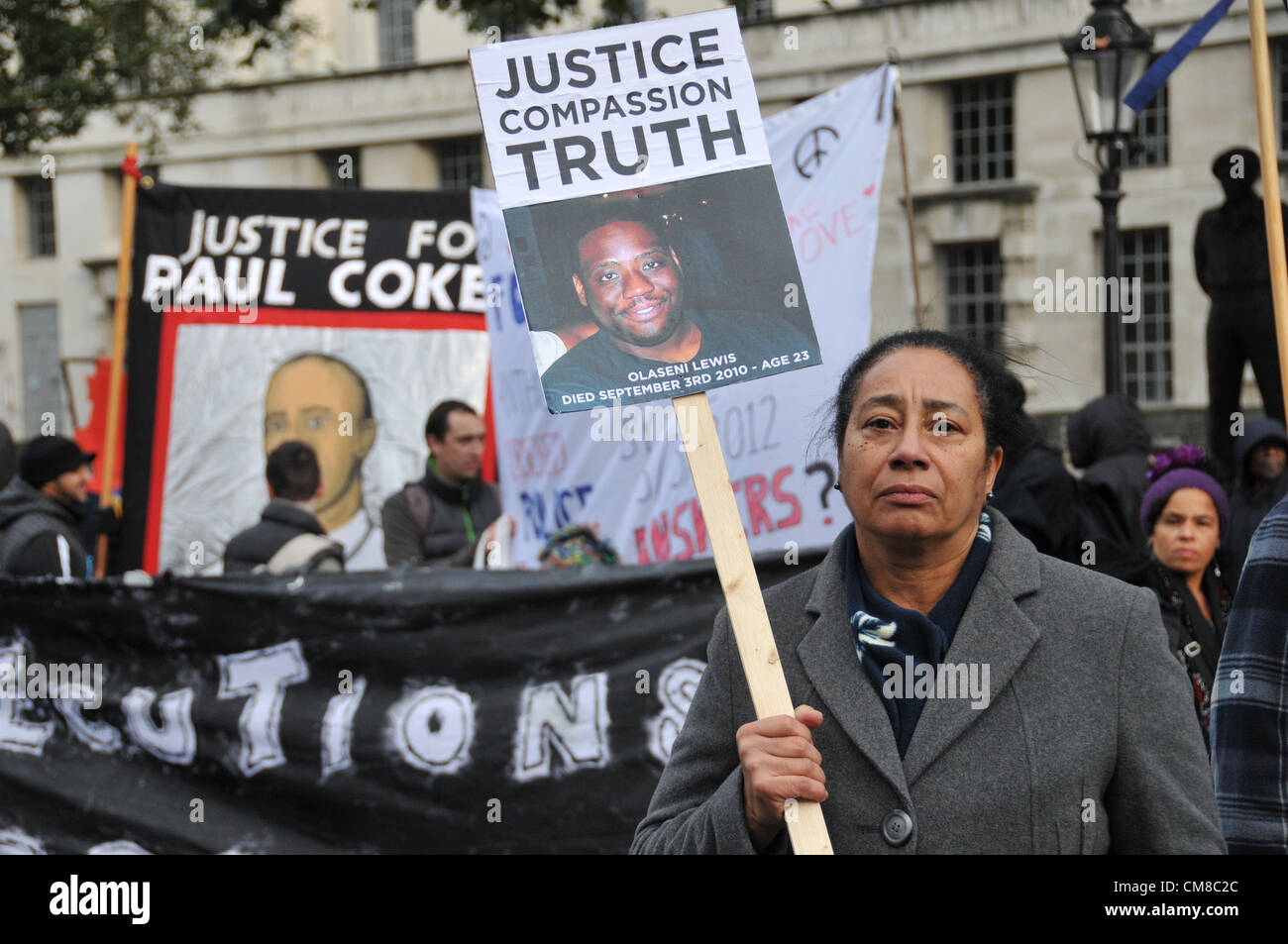 Whitehall, London, UK. 27th October 2012. A woman holds a banner during the UFFC protest. A protest by the UFFC - Stock Image