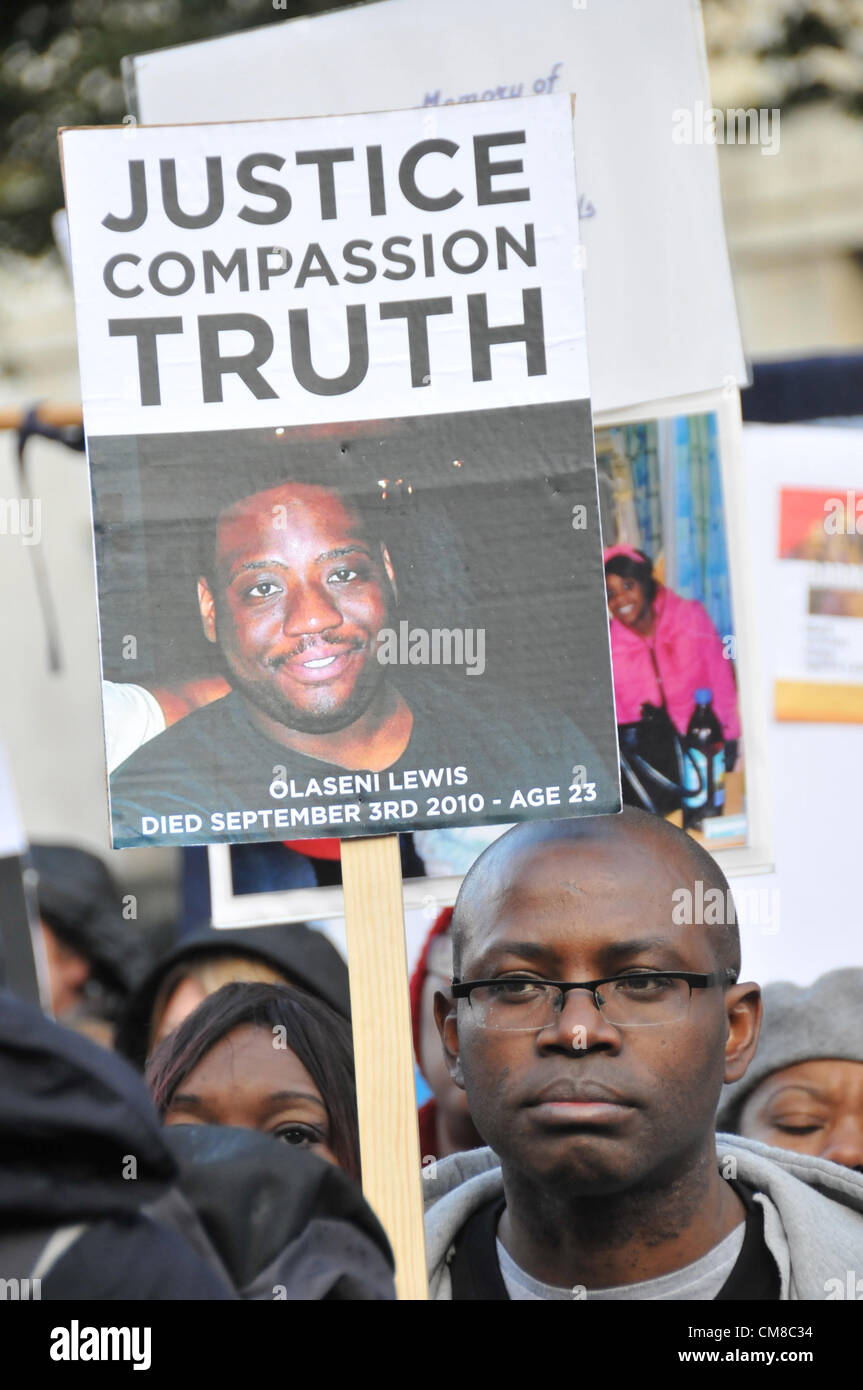Whitehall, London, UK. 27th October 2012. A man holding a banner during the UFFC protest. A protest by the UFFC - Stock Image